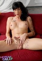 Alluring brunette tgirl exposing her huge cock