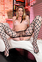 Black fishnet. Long-legged Morgan jerks in pantyhose